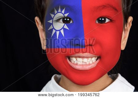 Asian Chinese Little Girl With Taiwan Flag On Face