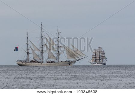TWO SAILING SHIPS - Shabab Oman and Cisne Branco on the horizon
