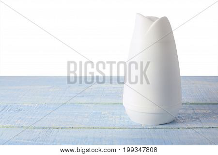 Bottle of Air Freshener on Wooden Background