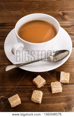 coffee in a cup with milk and brown sugar