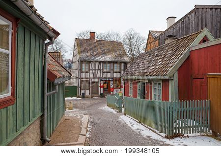 OSLO, NORWAY - 28 FEB 2016: Traditional Norwegian street with wooden houses. Old times in History of Norwegian culture Museum