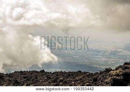 View between clouds from the top of the Etna volcano of Sicilian territory