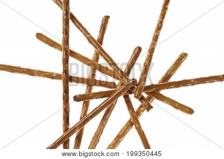 closeup of some crossed salt sticks in white back