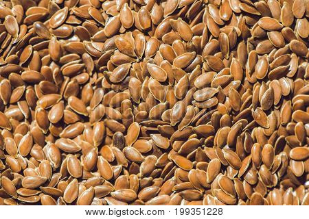 Brown Flax Seed Background. Flax Seed Is A Good Source Of Omega-3 Fatty Acids, Can Aid In Digestion,