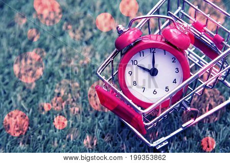 Red clock on the shopping cart lack of time waste of time purchasing time Shopping concept Business concept.