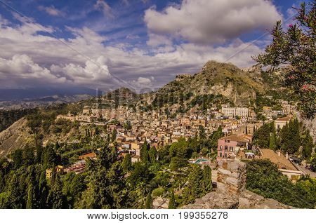 Panoramic view of the sicilian territory and the sicilian city of taormina and the vegetation and mountains that surround it