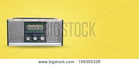 Vintage radio on pastel color background. retro technology. flat lay top view hero header. vintage color styles.
