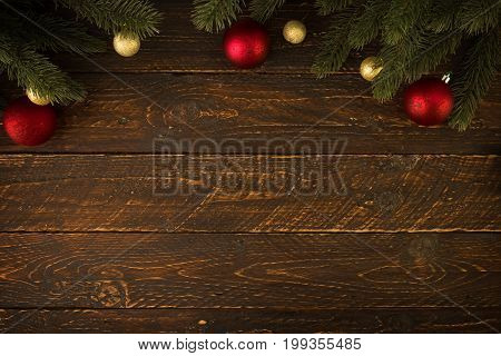 Christmas background - Christmas fir tree and decorating rustic elements on vintage wood table. Creative Flat layout and top view composition with border and copy space design. vintage color tone