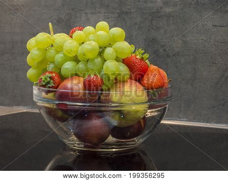 Glass Bowl Of Fresh Washed Fruit - Apples Bunch Of Grapes Strawberry And Nectarine