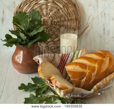 Still life with sliced bread and chilled milk.