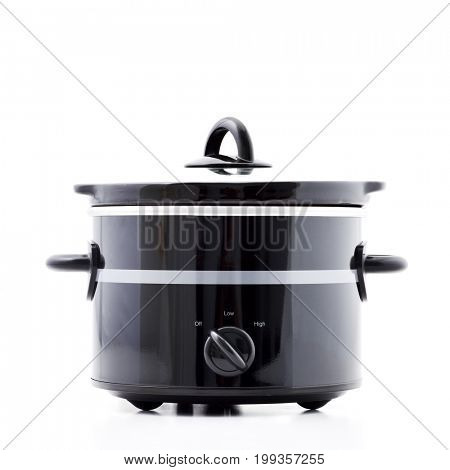 electric kitchen machine - slow cooker isolated on white background