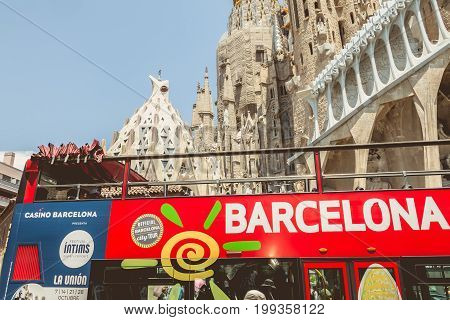A Tourist Bus Is Parked In Front Of The Sagrada Familia