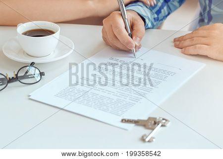 Young couple rent apartment together in the office signing contract