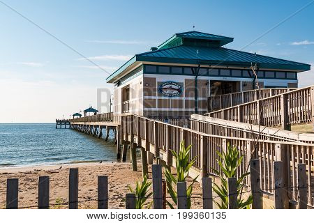 HAMPTON, VIRGINIA - JULY 9, 2017:  A ramp leading to the James T. Wilson fishing pier at Buckroe Beach.  Once a tobacco plantation, the area is now popular for the beach, fishing and a public park.