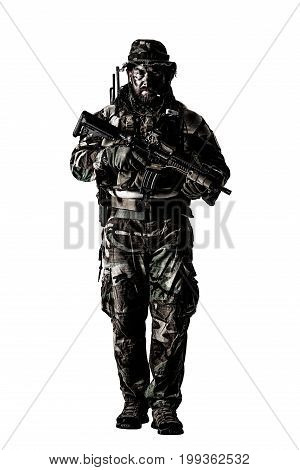 Special forces United States in Camouflage Uniforms studio shot. Holding weapons, wearing jungle hat, Shemagh scarf, painted face, his outfit clothes designed for jungle warfare. Studio shot isolated