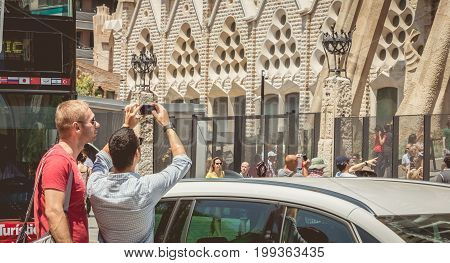 Tourists Taking Pictures In Front Of The Sagrada Familia