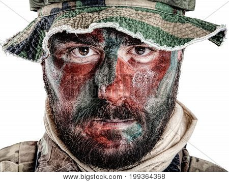 Special forces United States in Camouflage Uniforms studio shot. Wearing jungle hat, Shemagh scarf, painted with red and green face. Studio shot isolated