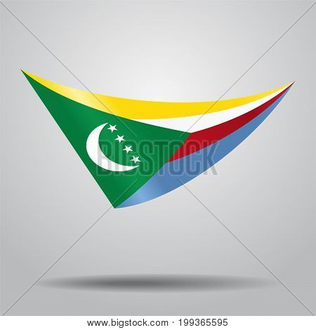 Comoros flag wavy abstract background. Vector illustration.