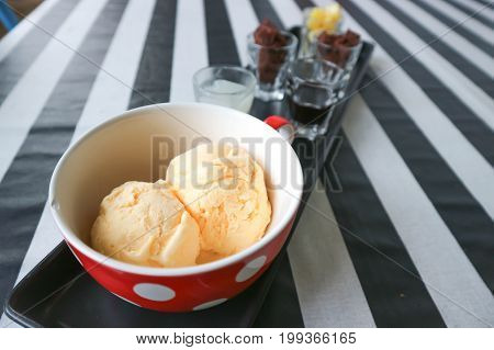 two scoops of ice cream and dip