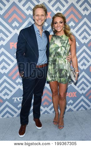 LOS ANGELES - AUG 08:  Chris Geere and Jennifer Sawdon arrives for the FOX TCA Summer Press Tour 2017 on August 8, 2017 in West Hollywood, CA