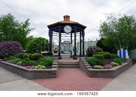 CADILLAC, MICHIGAN / UNITED STATES - MAY 31, 2017:  One may refer to a map of downtown Cadillac, inside a pavilion in a small park in Downtown Cadillac's Lakeside District.