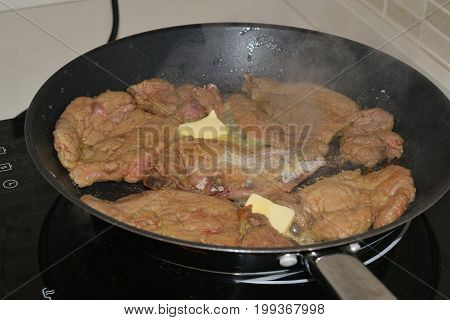 Cooking Meat In A Pan On An Induction Plate