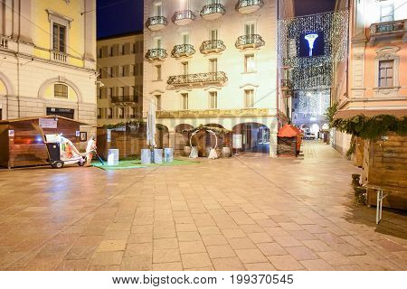 Woman Worker Cleaning The Central Square With The Christmas Market