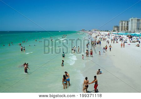 People enjoying water, beach, pier, skyline in Clearwater Beach Florida, Spring Break, April 23, 2017