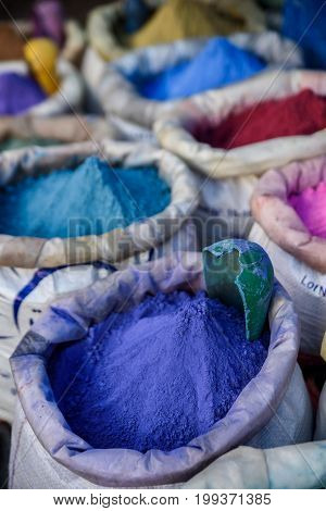 Bags with colourful powder for paint Chefchaouen. Morocco