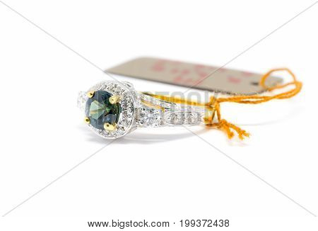 Closed Up Blue Sapphire  With White Diamond And Gold Ring Isolated