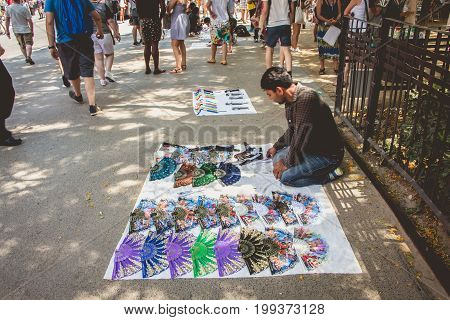 Street Vendor Offers Souvenirs To Tourists Visiting The Catalan Capital