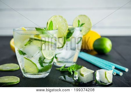 Citrus cocktail with crushed ice and lame with lemons