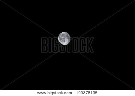Isolated waning moon in the night sky