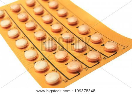 Oral contraceptive on white background