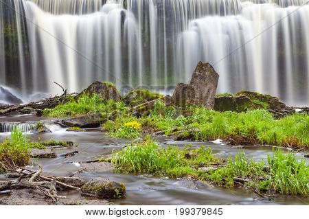 Keila Joa waterfall, long exposure and spring time with greenery.