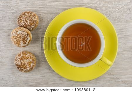 Cup Of Tea And Honey-cake On Wooden Table