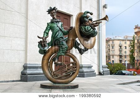 MINSK, BELARUS - AUGUST 04, 2012: City bronze sculpture of clowns with music instruments near the Belarusian state circus. The sculpture was installed in 2010. Sculptor Sergey Bondarenko.