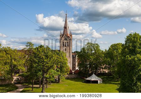 Cathedral aerial view, is a part of ancient Livonian castle in old town of Cesis, Latvia. Greenery and summer daytime.