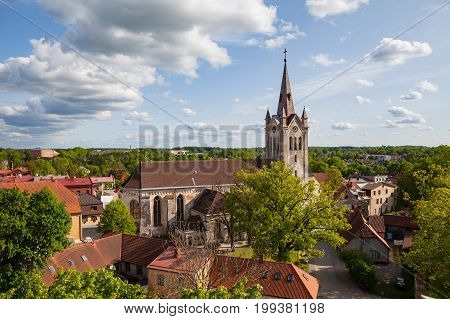 Medieval church of Saint John and aerial view of old town of Cesis, Latvia. Greenery and summer daytime,
