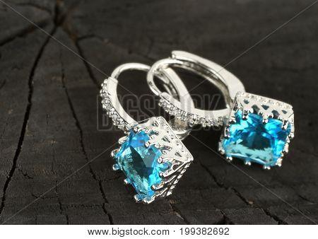 jewelry Earrings on black wood background copy-space