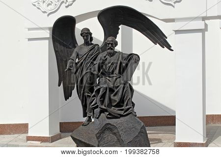 MINSK, BELARUS - AUGUST 01, 2013: Statue of Saint Apostle and Evangelist John the Theologian by sculptor Alexander Dranets near the Theological Educational Center of the Belarusian Orthodox Church.