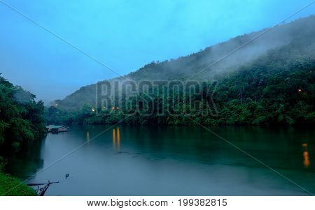 Mountain Forest With Fog And Houseboat On Kwai River Landscape On Rain In Kanchanaburi, Thailand. Na
