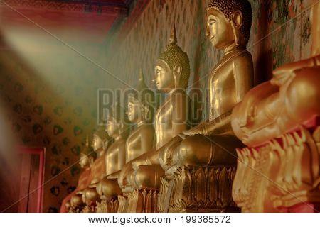 Row Of Golden Buddha Statue With Natural Sunlight Effect At Wat Arun, Bangkok Thailand. Landmark Of