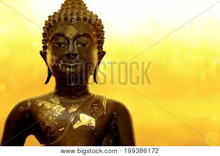 Buddha Statue Of Meditation Pose In Peaceful Atmosphere. Golden Background Is Part Of Huge Reclining