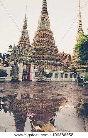 Water Reflection Of Old Pagoda In  Wat Arun, Bangkok Thailand
