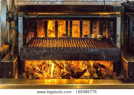 Indoor BBQ wood fire grill burning kitchen fire