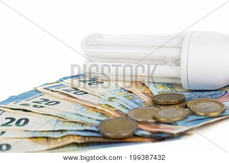 Light Bulb electric lamp on european banknotes. Concept of cost price of electricity and saving electricity with modern lamp. On white background