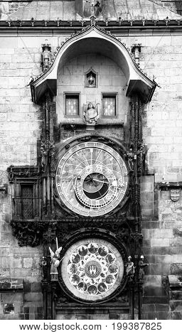 Prague astronomical clock, aka Orloj, on Old Town Hall Tower, Old Town Square, Prague, Czech Republic. Black and white image