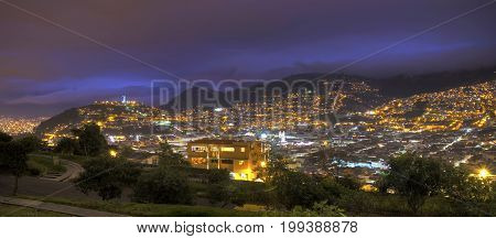 Panoramic view of downtown Quito, the Panecillo hill and the Ecuadorian Andes, moments after sunset. Quito, Pichincha, Ecuador.