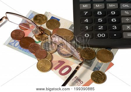 Euros coins glasses and calculator on white background isolated